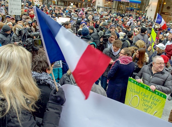 Supporters gather in Chicago, America hours after news of the first shootings broke. Americans too pledge their solidarity with France even as it grapples with its own inter-racial conflict in the wake of the controversial events in Ferguson during the latter half of 2014