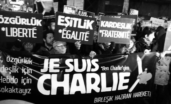 Supporters in Istanbul, Turkey, show solidarity even as its leaders raffle over appropriateness of Charlie Hebdo's role in its mostly Muslim society