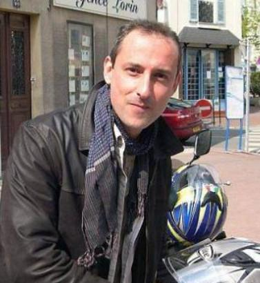 F  ranck Brinsolaro  seen here beside his motorcycle in 2012