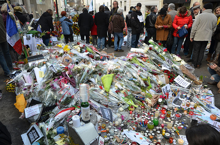 Flowers and tributes to the victims of the shooting lay on the ground in Paris as France reels from its shock