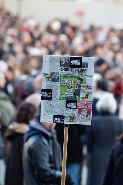 A sign at the march in Rennes, North-western France, showing a number of the Charlie Hebdo cartoons, some controversial