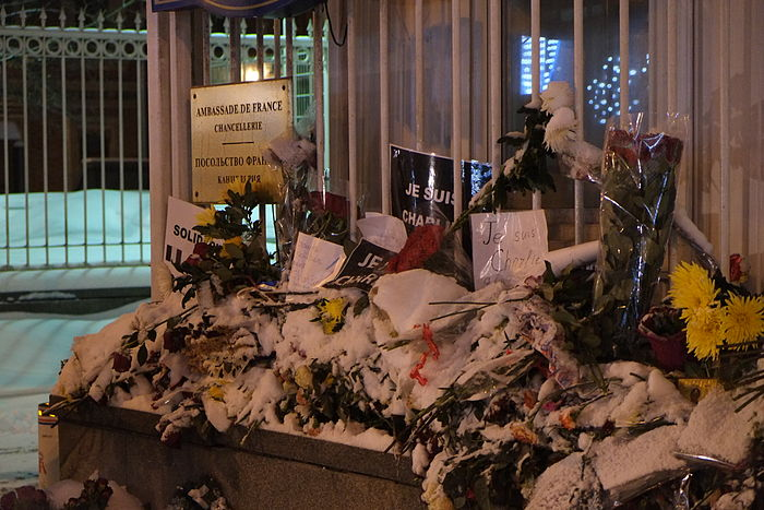 Snow-covered flowers and tributes outside the office of the French Ambassador in Moscow, Russia