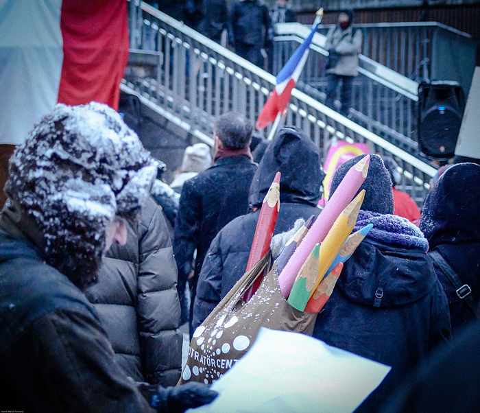 International support for Charlie Hebdo is apparent as protestors brave the cold in a rally in Stockholm, Sweden
