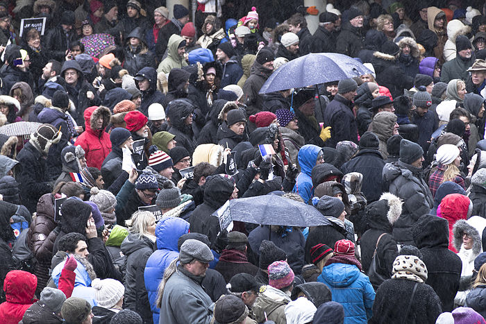 Supporters of Charlie Hebdo brave the cold  in a rally in Stockholm, Sweden