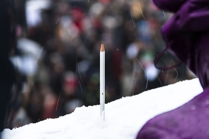 A pencil stuck in snow at the Stockholm rally in Sweden . A sign of standing values of Freedom of Expression