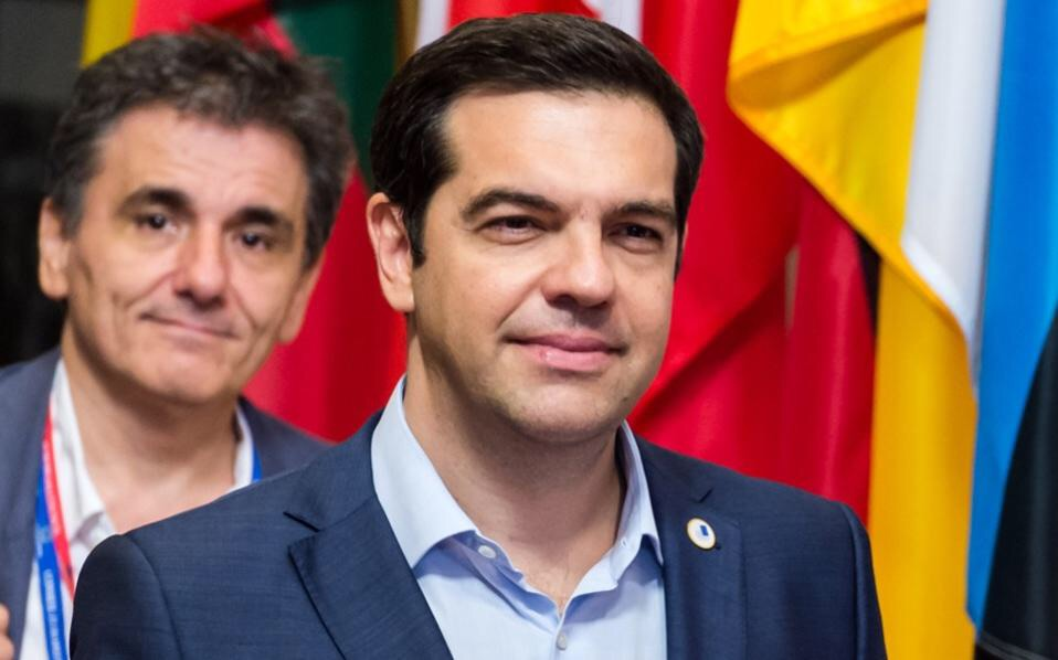 At least Tsipras is putting on a good fight by smiling to the press.  Photo: AFP