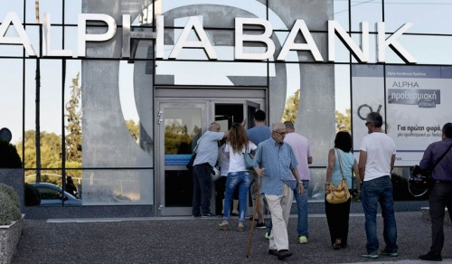 Alpha Bank, one of Greece's largest 4 banks, opened its branches to the public, ending an unprecedented 3-week long bank holiday. Capital controls limiting the amount despositors can withdrawal remain in place. Photo: AP