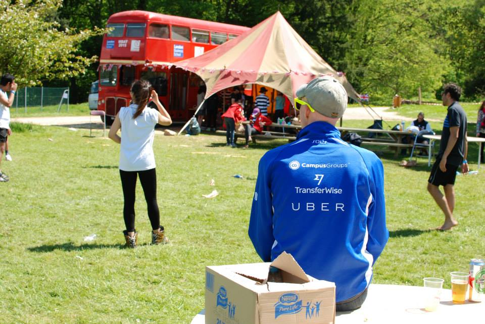 #8.  Enjoying the sun and lovely view of the iconic LBS bus and tent.  (via  MBAOnly )