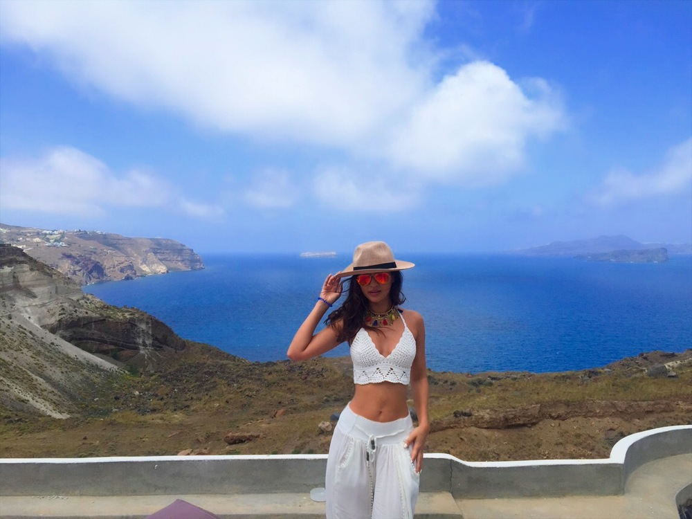 En route to Akrotori, wearing- Primark hat and necklace, Rayban aviators, Lily Lulu top, local market palazzo pants