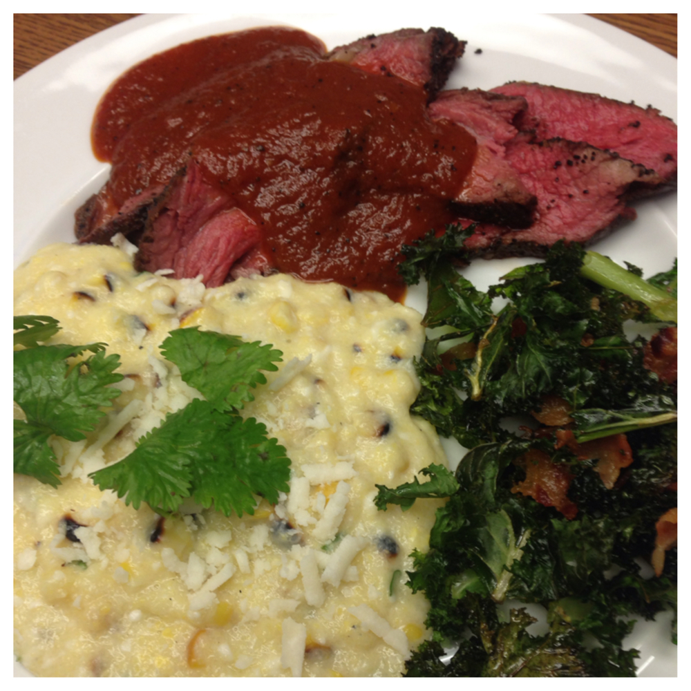 I SERVED THE STEAK WITH A SIDE OF MEXICAN CORN POLENTA AND KALE CHIPS WITH BACON.  I TOOK INFLUENCE FROM AMERICAN BARBECUE, MEXICAN AND ITALIAN CUISINES.  THE POLENTA HAS COCONUT MILK FOR SWEETNESS, ROASTED CORN, CILANTRO, LIME JUICE AND COTIJA CHEESE, ALL THE FLAVORS OF THE POPULAR MEXICAN STREET FOOD.  THE KALE IS A PLAY ON SOUTHERN GREENS THAT ARE USUALLY MADE WITH COLLARDS.  I WANTED A CRUNCHY TEXTURE IN THE DISH SO I MADE THEM INTO CHIPS AND ADDED BACON INSTEAD OF THE SMOKED HAM HOCK WHICH IS TYPICALLY FOUND IN GREENS.