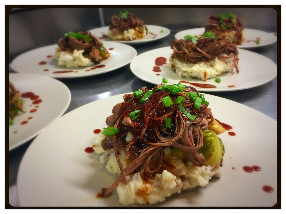 Bill served this brisket over roasted garlic mashed potatoes and charred bacon brussels sprouts