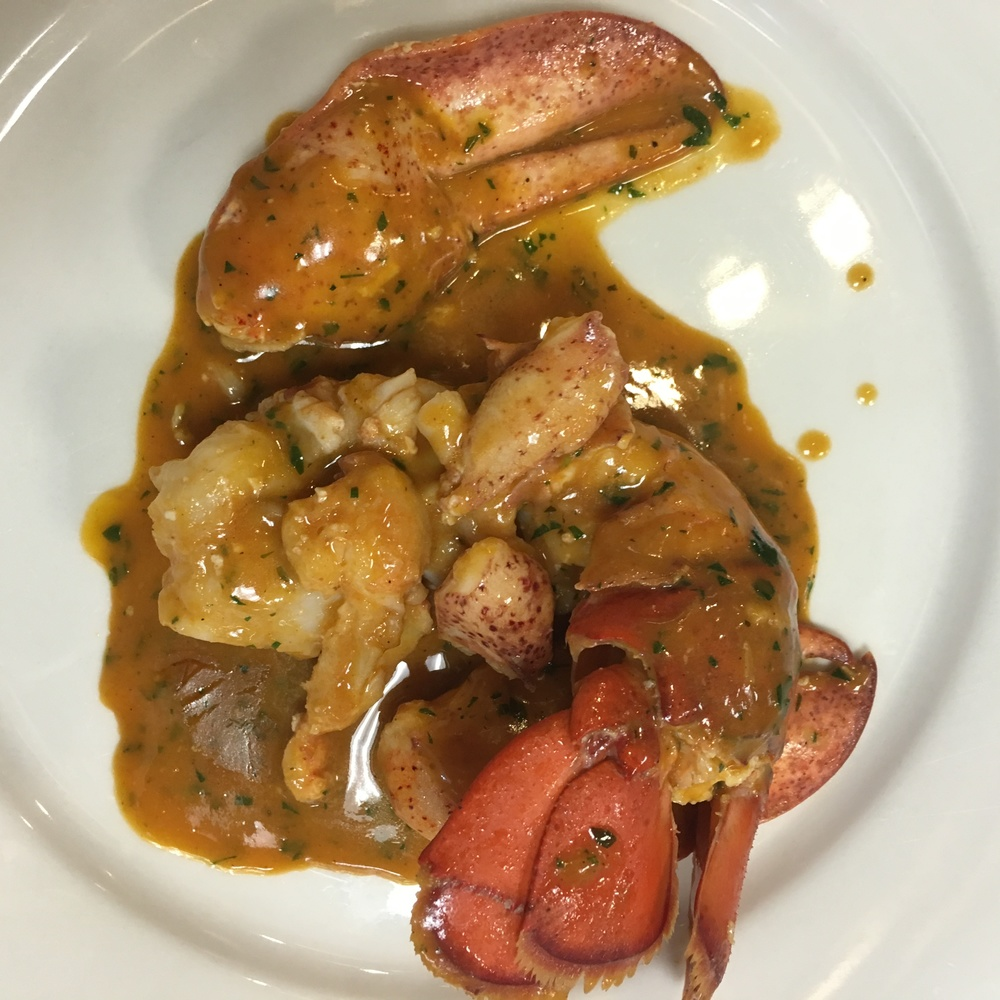 Lobster in Sauce Americaine, a crustacean sauce made with lobster shells, tomato, brandy and tarragon......and BUTTER!