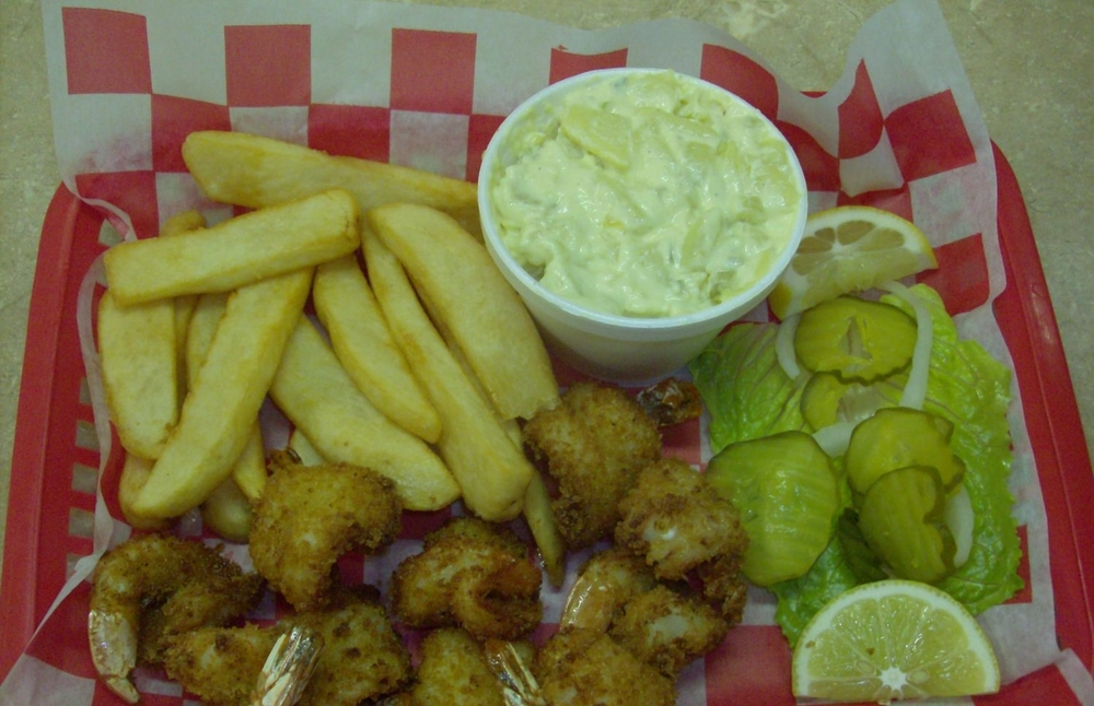 Shrimp plate with a side of Fries and potato salad