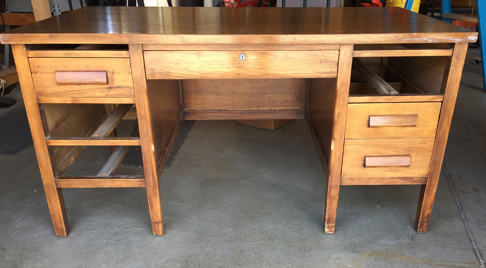 This nice old wood desk came with all the drawers. We just didn't put them all back in for the photo.