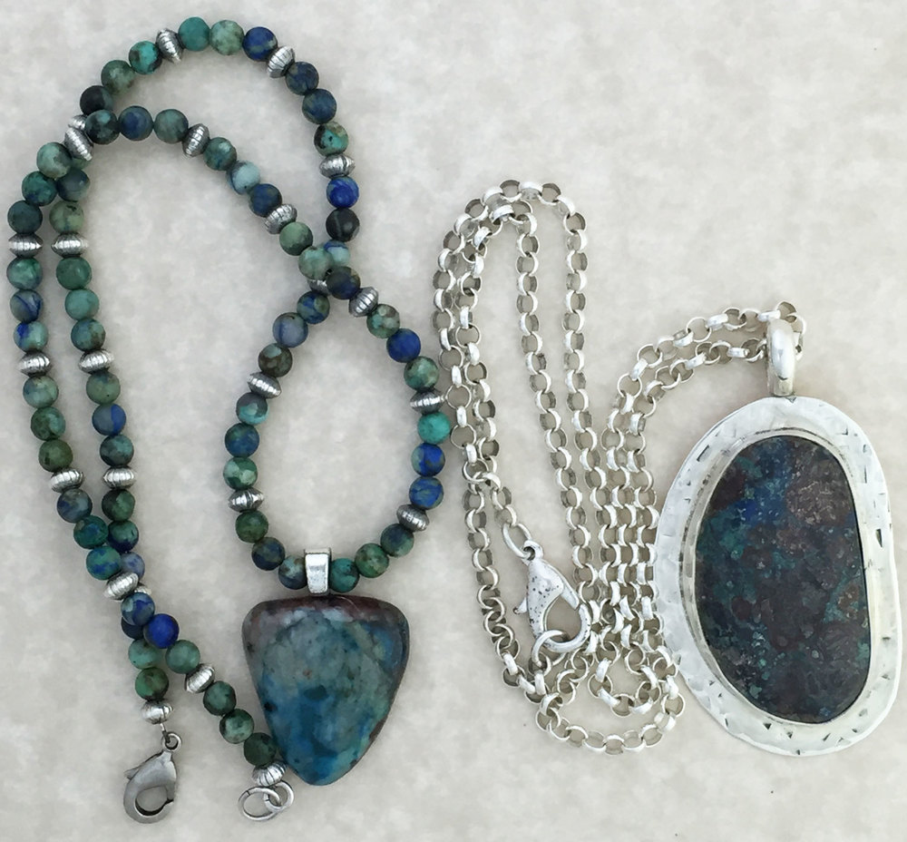 These two necklaces are from my personal jewelry collection. The stones in both pendants are chrysocolla, as well as the beads in the necklace on the left. (The beads are not made by us.)
