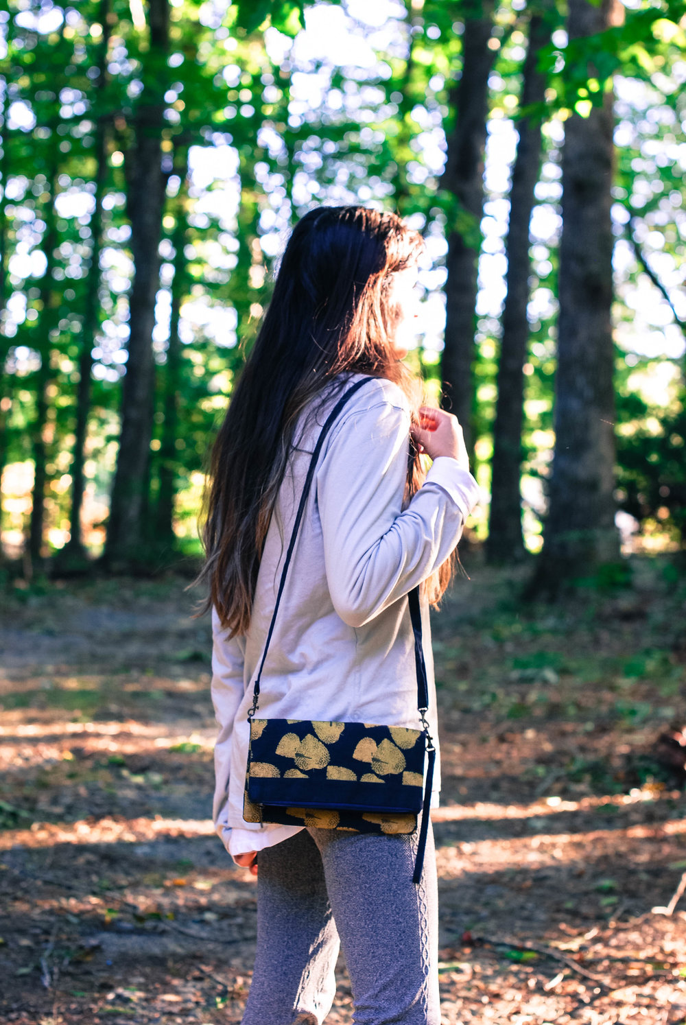 took the clutch on a little walk, too! {sweatshirt by  Saltura  / necklace in top photos by  Meridian Lee }
