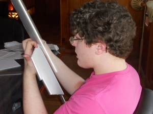 Perry Scalfano, 18, works on a series of Cubist futurist masks he's making for a movie he's making. Perry is a student at the Randolph School in Huntsville, Alabama, and was at the Writers' Colony at Dairy Hollow for four days on a spring break trip with 12 other students and two teachers.