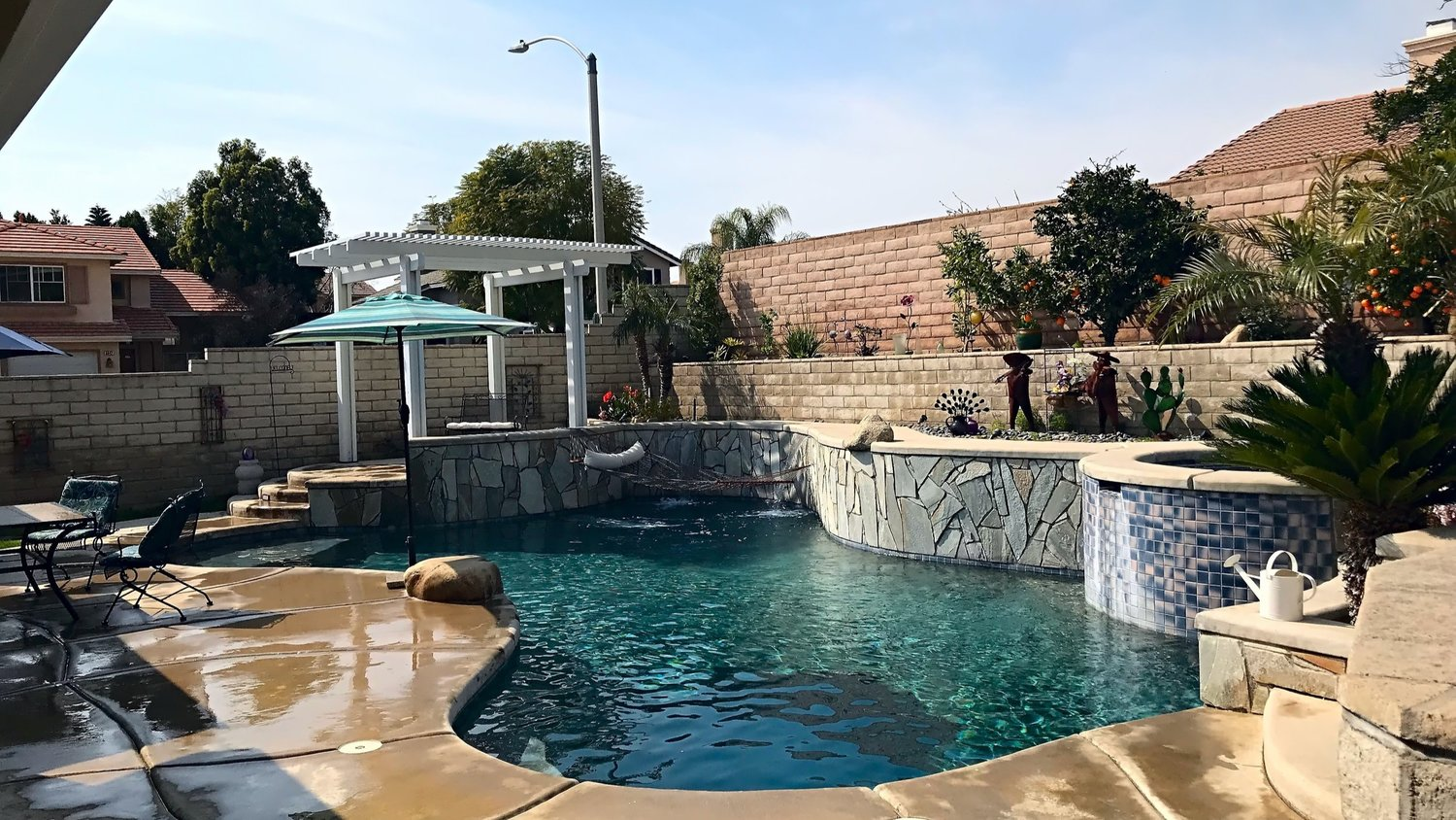 Swimming Pool Design with an Upslope — Bogner Pools