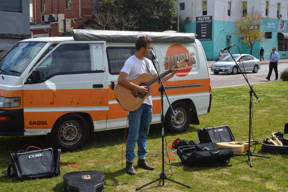 Adam Harpaz playing for a charity organisation while they feed the homeless people of Perth City