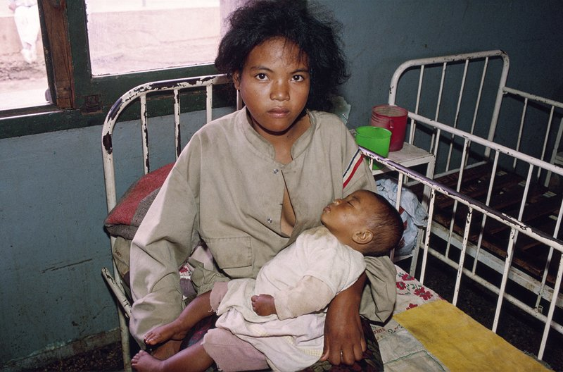 Woman & Child in Madascagar  by Reporter Photographer - Olivier Martel