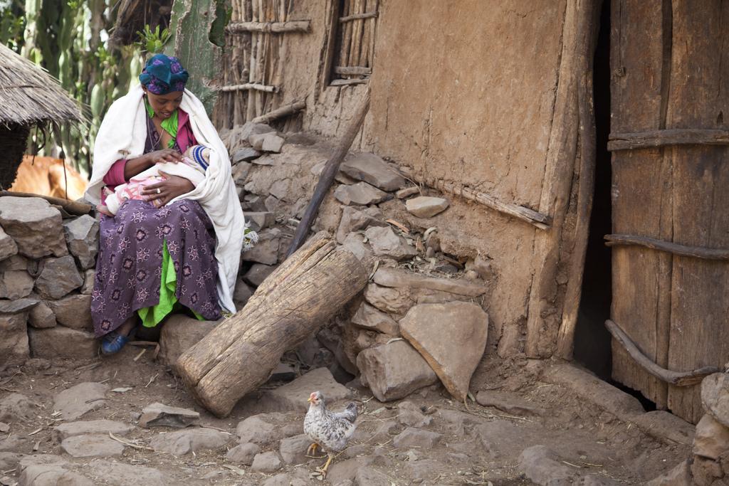 Kokeb Negussie breastfeeding her son Moges