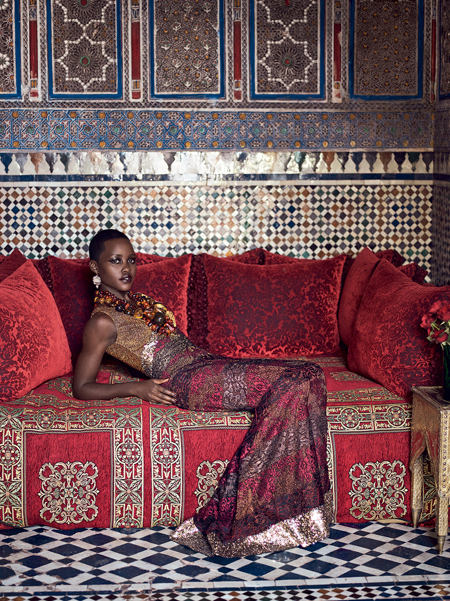 "PATTERN PLAY: When she was growing up in Kenya, Nyong'o says, acting ""wasn't a viable career path. It's not seen as a prestigious profession."" Rodarte metallic lace dress with sequins. Judy Geib Plus Alpha diamond–and–gold filigree earrings. Fred Leighton amber necklaces. Photographed in the tearoom at the Riad Madani. 