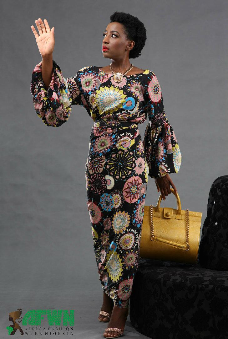 Oreka wearing Ade Bakare, handbag by Okiki Marinho