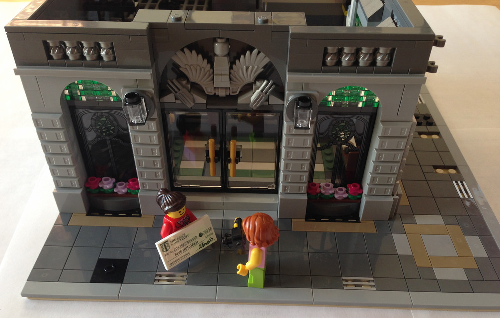 The Brick Bank Is A Corner Building The Bank Side Is Shown Here With The Second Set Of Bags Complete It Comes With 2 Minifigures A Girl And A Woman