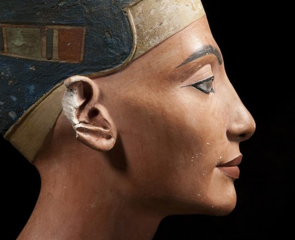 Compare the image on Tutankhamun's tomb wall with the Nefertiti's famous bust in Berlin. Thejawline, brow, nose, chin, and distinctive 'oromental groove' all match.Reeves suggests that the Osiride 'king' is in fact Nefertiti and that the figure of the king performing the Opening of the Mouth ceremony is Tutankhamun, officiating at the burial of his predecessor.