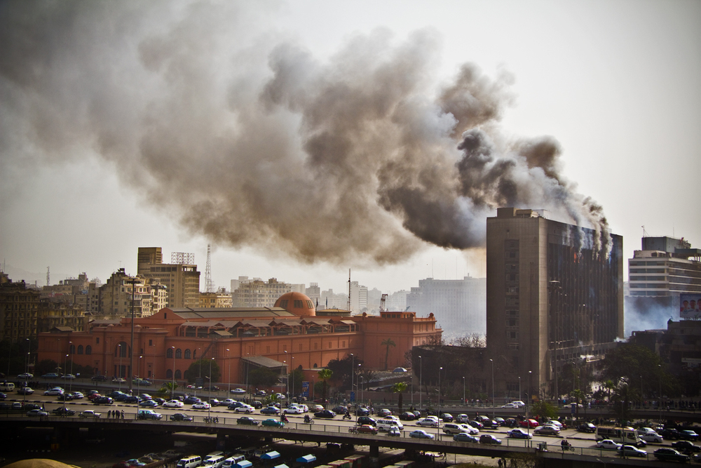 The National Democratic Party Headquarters burn in January 2011, right next to the Egyptian Museum in Cairo. Photo: Dan H.