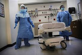 PICTURES OF NURSES WEARING EBOLA OUTFITS