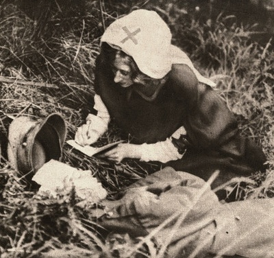 A Red Cross nurse writes down the last words of a British soldier, WWI. Paul Thompson