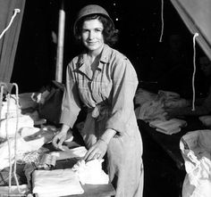 Historic: A nurse from the Army Nurse Corps preparing dressings in a tent at the 13th Field Hospital Saint Laurent sur Mer near Omaha Beach near Omaha Beach on June 15, 1944. Nurses arrived in the combat zone after the 12th of June