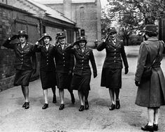 In this May 5, 1944 file photo, five members of the Women's Army Corps serving with the army service of supplies, salute an officer at a base in England. More than 150,000 American women served in the WAC during World War II, becoming the first women other than nurses to serve in the United States Army.