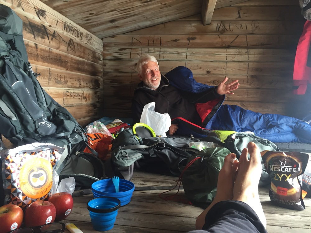 Jan enjoying ourwooden shelter home - waiting for the bad weatherto pass