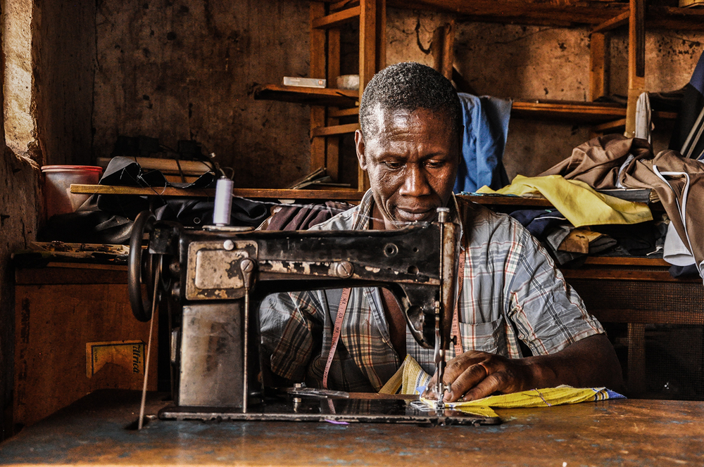 Mr. Byarugaba, also a father of four, runs a tailoring business next door and is now able to take on bigger orders since lighting up his shop a month ago.