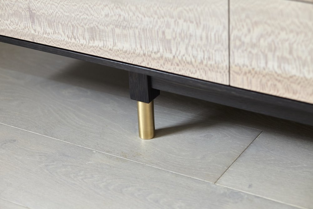 Adjustable brass cabinet foot.jpg
