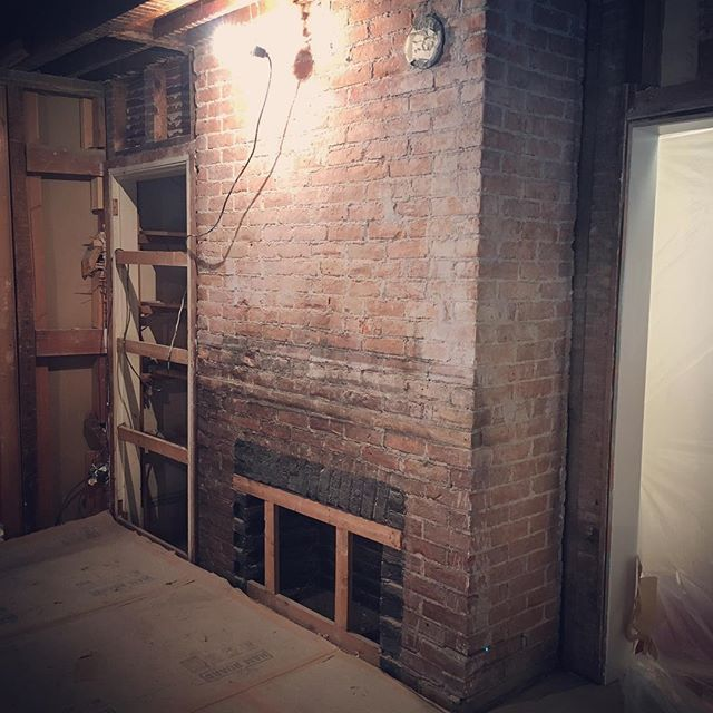 It's exciting when an original brick fireplace is uncovered during demolition! Can't wait to work this new find into the design plan! #kristinashleyinteriors #madisonmemorial #fireplace #originalfireplace #demo #brickfireplace #madisonnj #bernardsvilledesigner