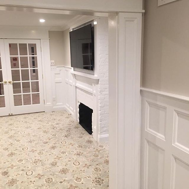 We uncovered this fireplace during demolition and added decorative mouldings, new doors, lights, carpet and paint. What a transformation! Swipe over to see the before! #kristinashleyinteriors #madisonmemorial #madisonmemorialhome #commercialinteriors #madisonnj #bernardsvilledesigner #transformation #interiordesign #moulding #mouldings #woodworking