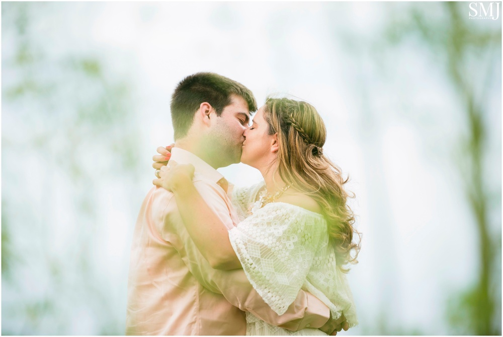 This is definitely one of my favorites from the entire shoot. I got on the ground and shot through some nearby wheat grass and it creamed a dreamy effect for a dreamy moment between the two of them.