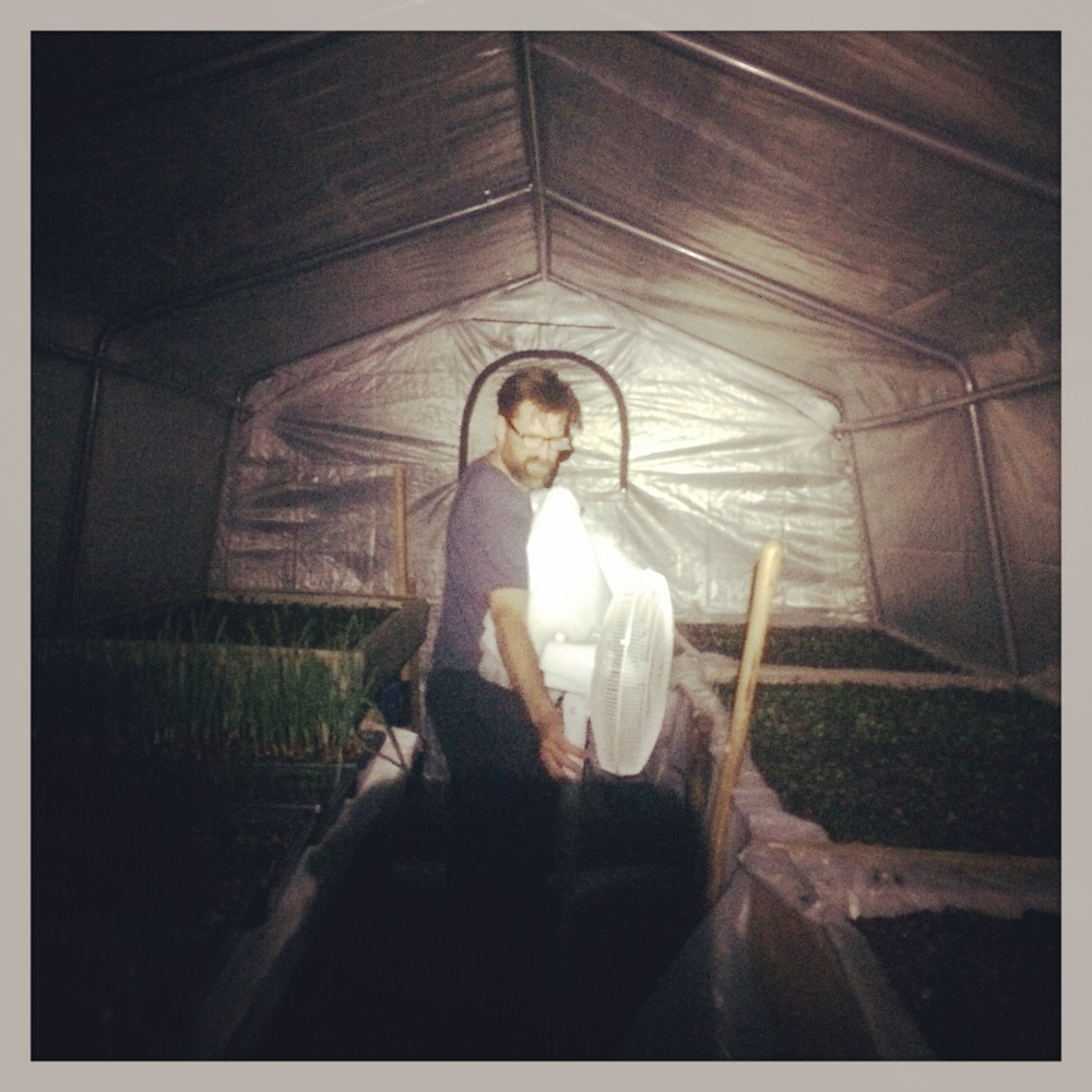 Night time greenhouse adventures. Moving the fan around since we bumped up some seedlings that day!