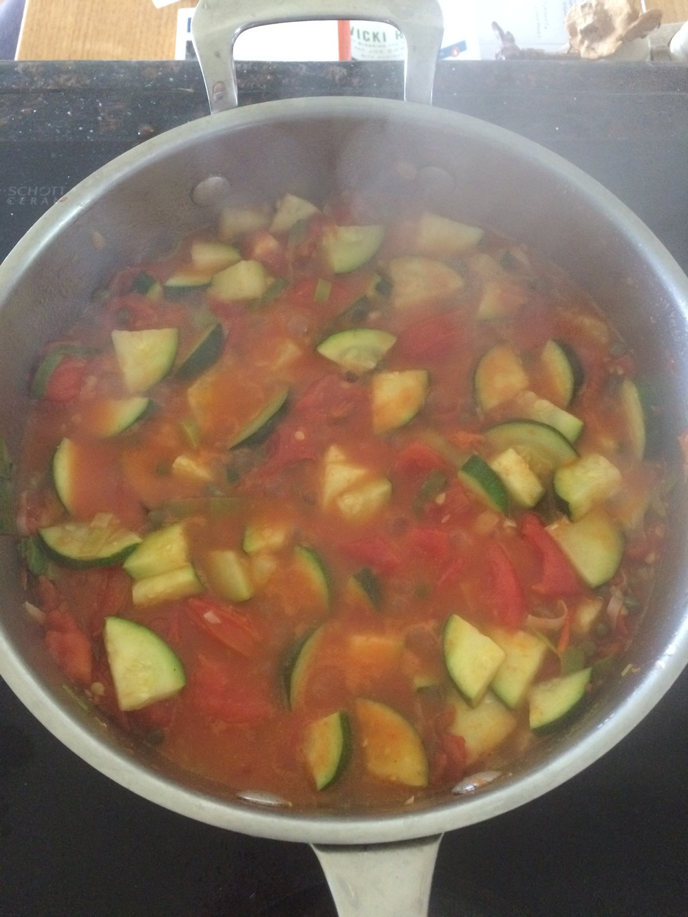 Fresh tomatoes, garlic, and leek pasta sauce with zucchini. Topped with fresh basil.