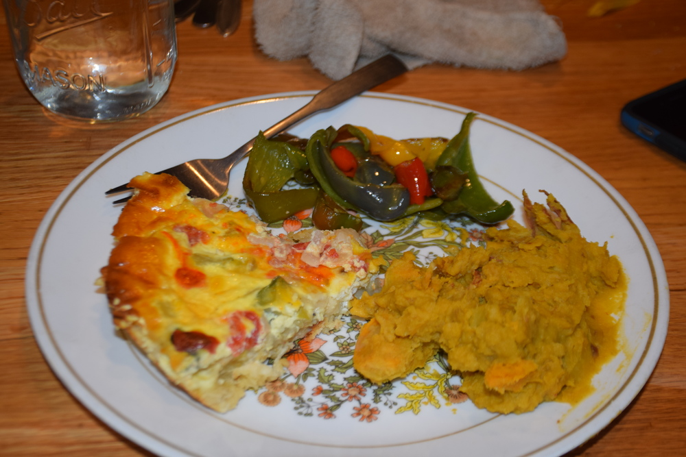 Mashed sweet taters, quiche and sauteed peppers