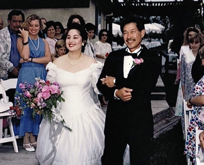 My dad escorting me down the aisle.