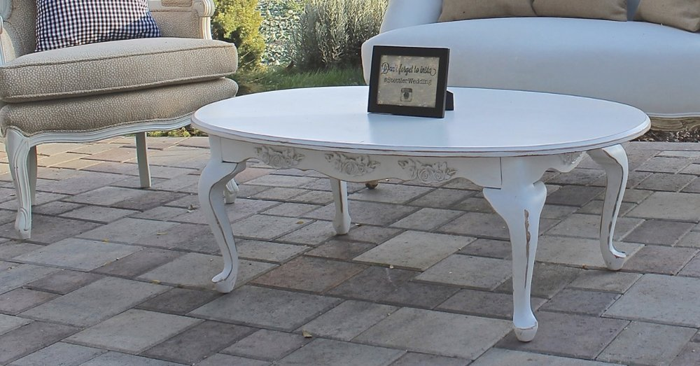 OVAL COFFEE TABLE (WHITE) - $50