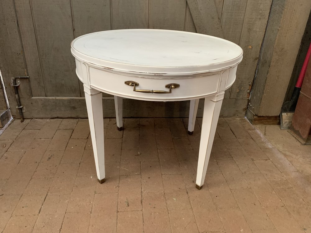 WHITE ROUND ACCENT TABLE - $35