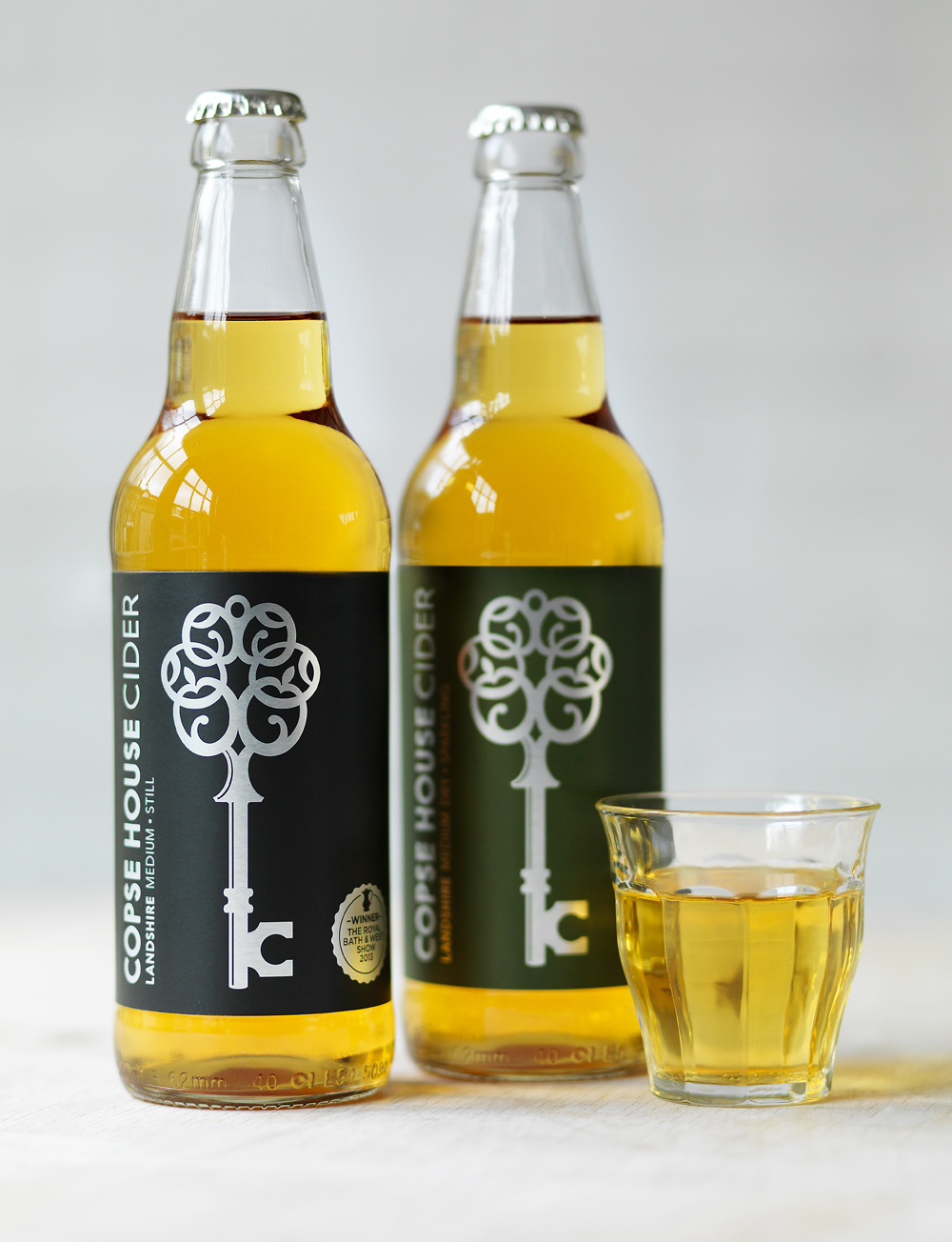 Copse House Cider on table.jpg