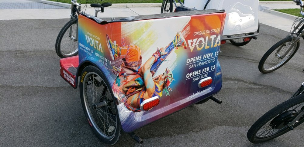 Catch a ride to the show in one of Cabrio's Volta themed pedicabs!
