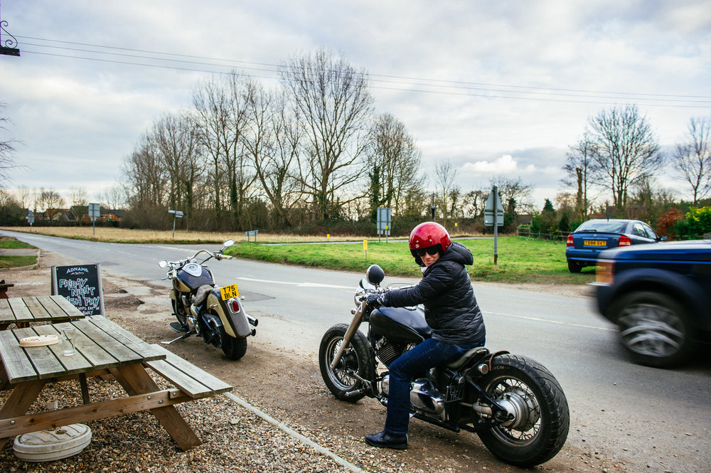 Me on Ghed's bobber in Suffolk, England. That's his 1600cc Winstar in front, which I have ridden several times. It's like driving a lazyboy couch.