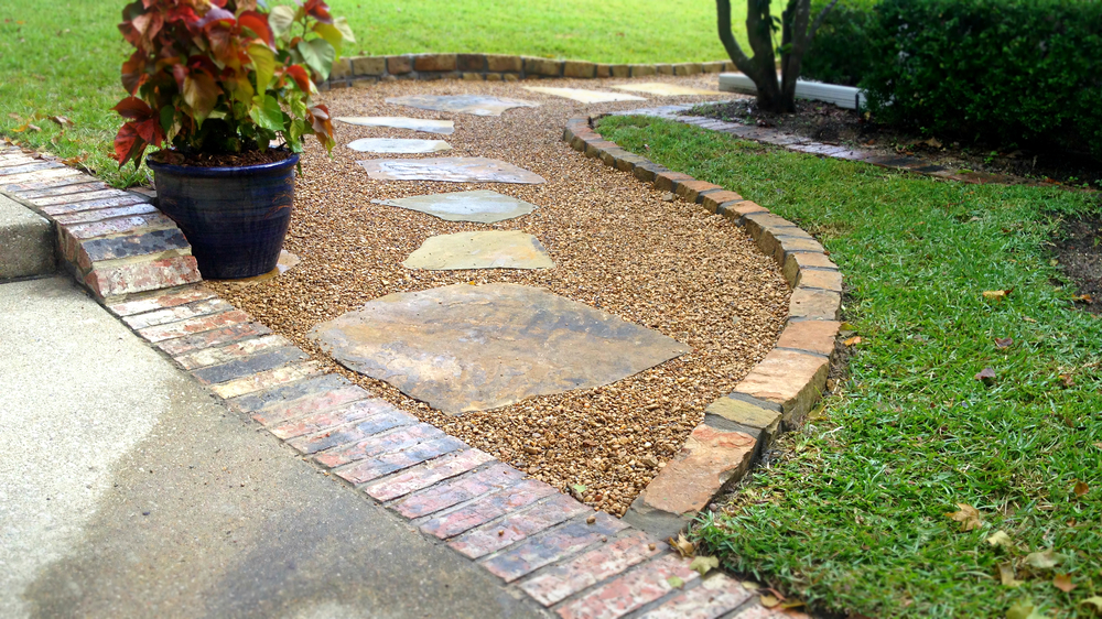 Drainage collection areas can serve multiple purposes. This flagstone and gravel walk serves a dual purpose as a French drain.